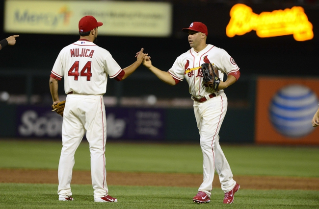 Aug 24, 2013; St. Louis, MO, USA; St. Louis Cardinals right fielder Carlos Beltran (3) celebrates with relief pitcher Edward Mujica (44) after defeating the Atlanta Braves at Busch Stadium. St. Louis defeated Atlanta 6-2. Mandatory Credit: Jeff Curry-USA TODAY Sports
