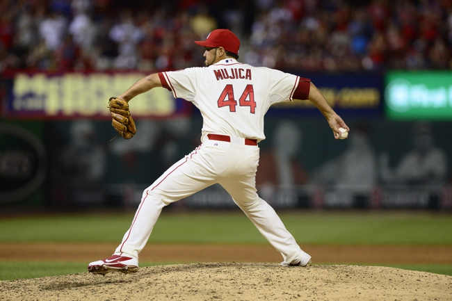 Aug 24, 2013; St. Louis, MO, USA; St. Louis Cardinals relief pitcher Edward Mujica (44) throws to a Atlanta Braves batter during the ninth inning at Busch Stadium. St. Louis defeated Atlanta 6-2. Mandatory Credit: Jeff Curry-USA TODAY Sports