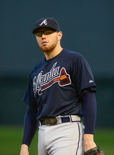 Aug 24, 2013; St. Louis, MO, USA; Atlanta Braves first baseman Freddie Freeman (5) looks on during the fourth inning against the St. Louis Cardinals at Busch Stadium. St. Louis defeated Atlanta 6-2. Mandatory Credit: Jeff Curry-USA TODAY Sports