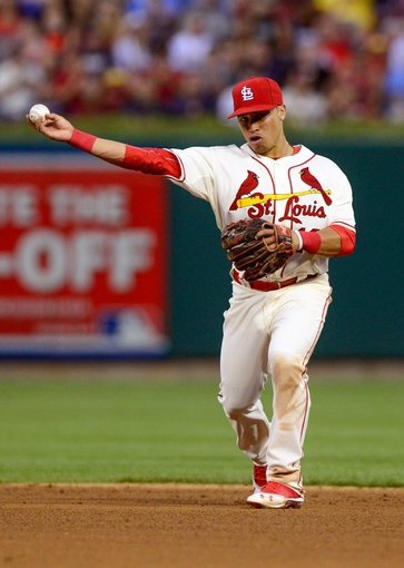 Aug 24, 2013; St. Louis, MO, USA; St. Louis Cardinals second baseman Kolten Wong (16) throws out Atlanta Braves first baseman Freddie Freeman (not pictured) during the sixth inning at Busch Stadium. St. Louis defeated Atlanta 6-2. Mandatory Credit: Jeff Curry-USA TODAY Sports