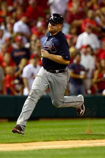 Aug 24, 2013; St. Louis, MO, USA; Atlanta Braves catcher Brian McCann (16) scores on a double by pinch hitter Gerald Laird (not pictured) during the ninth inning against the St. Louis Cardinals at Busch Stadium. St. Louis defeated Atlanta 6-2. Mandatory Credit: Jeff Curry-USA TODAY Sports