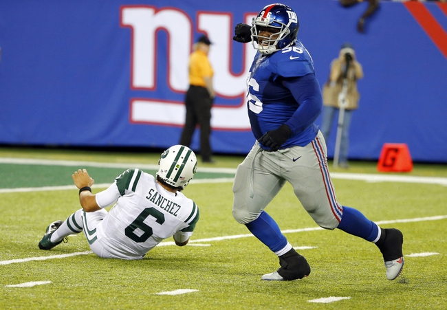 Aug 24, 2013; East Rutherford, NJ, USA; New York Giants defensive tackle Marvin Austin (96) celebrates sack of New York Jets quarterback Mark Sanchez (6) on his first play from scrimmage during the second half at MetLife Stadium. New York Jets defeat the New York Giants 24-21 in OT. Mandatory Credit: Jim O'Connor-USA TODAY Sports