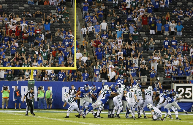 Aug 24, 2013; East Rutherford, NJ, USA; New York Jets place kicker Billy Cundiff (8) kicks winning field goal against the New York Giants in OT at MetLife Stadium. New York Jets defeat the New York Giants 24-21 in OT. Mandatory Credit: Jim O'Connor-USA TODAY Sports