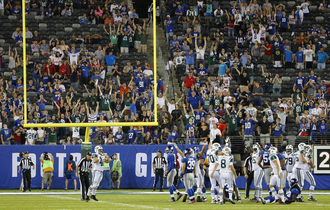 Aug 24, 2013; East Rutherford, NJ, USA; New York Jets and fans celebrate winning field goal in OT by place kicker Billy Cundiff (8) at MetLife Stadium. New York Jets defeat the New York Giants 24-21 in OT. Mandatory Credit: Jim O'Connor-USA TODAY Sports