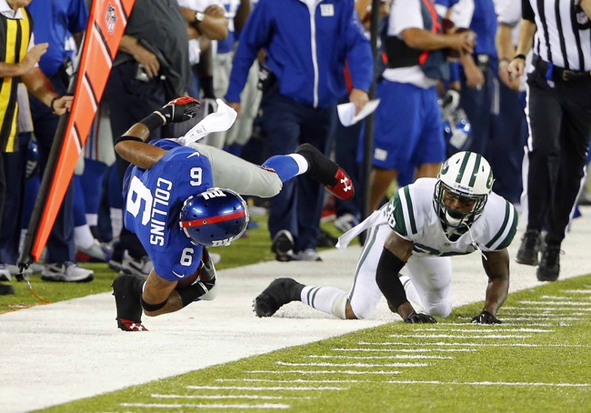 Aug 24, 2013; East Rutherford, NJ, USA; New York Giants wide receiver Brandon Collins (6) is tripped up by New York Jets defensive back Royce Adams (38) during the second half at MetLife Stadium. New York Jets defeat the New York Giants 24-21 in OT. Mandatory Credit: Jim O'Connor-USA TODAY Sports