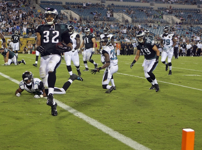 Aug 24, 2013; Jacksonville, FL, USA; Philadelphia Eagles running back Chris Polk (32) skips into the end zone to score the game-winning touchdown during the fourth quarter of their game against the Jacksonville Jaguars at EverBank Field. The Philadelphia Eagles beat the Jacksonville Jaguars 31-24. Mandatory Credit: Phil Sears-USA TODAY Sports