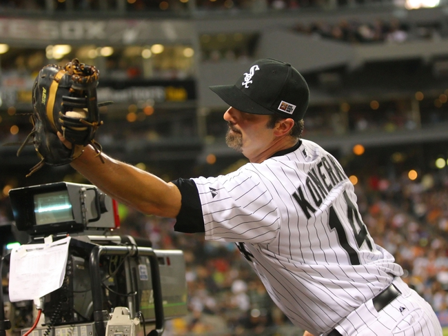 Aug 24, 2013; Chicago, IL, USA; Chicago White Sox first baseman Paul Konerko (14) falls into the dugout to catch a pop up off the bat of Texas Rangers shortstop Jurickson Profar (not pictured) during the seventh inning at US Cellular Field. Chicago won 3-2. Mandatory Credit: Dennis Wierzbicki-USA TODAY Sports