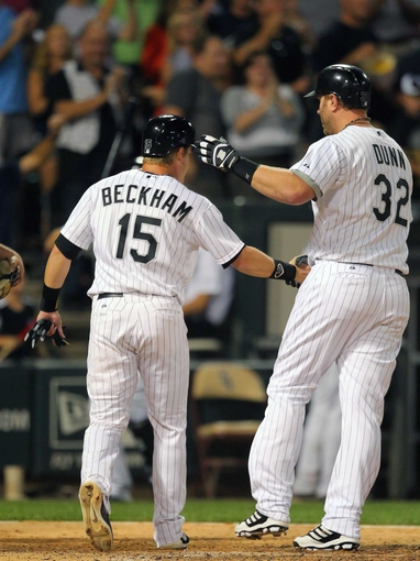 Aug 24, 2013; Chicago, IL, USA; Chicago White Sox first baseman Adam Dunn (32) is congratulated for hitting a 2 run home run by second baseman Gordon Beckham (15) during the sixth inning against the Texas Rangers at US Cellular Field. Chicago won 3-2. Mandatory Credit: Dennis Wierzbicki-USA TODAY Sports