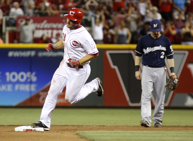 Aug 24, 2013; Cincinnati, OH, USA; Cincinnati Reds left fielder Chris Heisey (28) rounds the bases past Milwaukee Brewers second baseman Scooter Gennett (2) after Heisey hit a solo home run in the fifth inning at Great American Ball Park.The Reds defeated the Brewers 6-3. Mandatory Credit: David Kohl-USA TODAY Sports