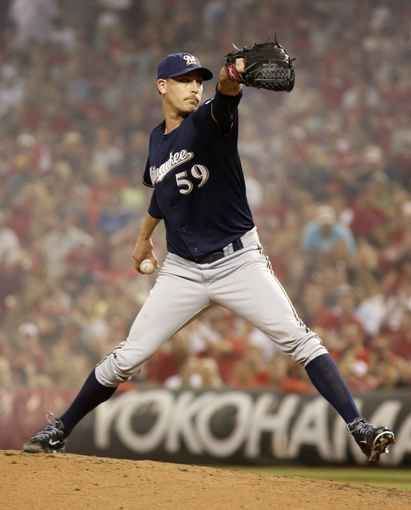 Aug 24, 2013; Cincinnati, OH, USA; Milwaukee Brewers relief pitcher John Axford throws against the Cincinnati Reds in the sixth inning at Great American Ball Park. The Reds defeated the Brewers 6-3. Mandatory Credit: David Kohl-USA TODAY Sports