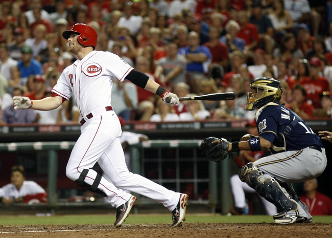 Aug 24, 2013; Cincinnati, OH, USA; Cincinnati Reds shortstop Zack Cozart (2) watches his two-run home run hit off Milwaukee Brewers relief pitcher John Axford (not pictured) in the sixth inning at Great American Ball Park. The Reds defeated the Brewers 6-3. Mandatory Credit: David Kohl-USA TODAY Sports
