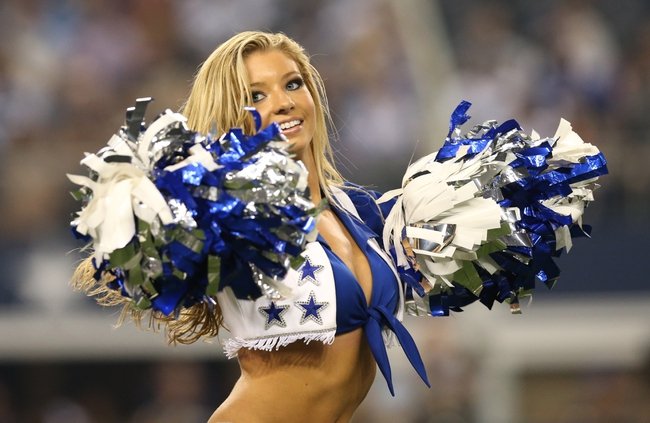 Aug 24, 2013; Arlington, TX, USA; Dallas Cowboys cheerleader Kinzie Ryanne performs during a timeout from the game against the Cincinnati Bengals at AT&T Stadium. The Cowboys beat the Bengals 24-18. Mandatory Credit: Matthew Emmons-USA TODAY Sports