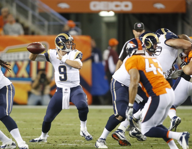 Aug 24, 2013; Denver, CO, USA; St. Louis Rams quarterback Austin Davis (9) looks to pass the ball during the second half against the Denver Broncos at Sports Authority Field at Mile High. The Broncos won 27-26.  Mandatory Credit: Chris Humphreys-USA TODAY Sports
