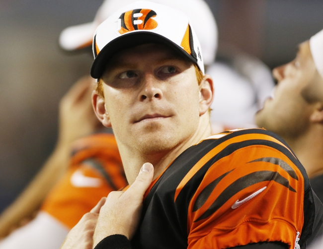 Aug 24, 2013; Arlington, TX, USA; Cincinnati Bengals quarterback Andy Dalton (14) on the sidelines during the game against the Dallas Cowboys at AT&T Stadium.  The Cowboys won 24-18. Mandatory Credit: Tim Heitman-USA TODAY Sports