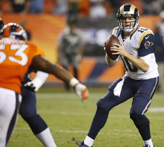 Aug 24, 2013; Denver, CO, USA; St. Louis Rams quarterback Kellen Clemens (10) looks to pass the ball during the second half against the Denver Broncos at Sports Authority Field at Mile High. The Broncos won 27-26.  Mandatory Credit: Chris Humphreys-USA TODAY Sports