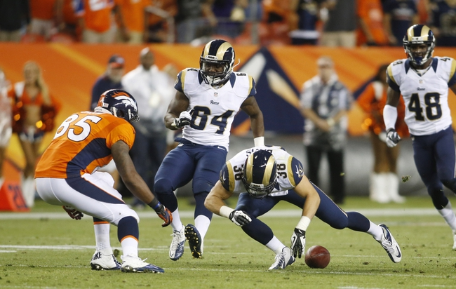 Aug 24, 2013; Denver, CO, USA; Denver Broncos tight end Virgil Green (85) and St. Louis Rams safety Cody Davis (38) go after an on sides kick during the second half at Sports Authority Field at Mile High. Denver recovered the ball.  The Broncos won 27-26.  Mandatory Credit: Chris Humphreys-USA TODAY Sports