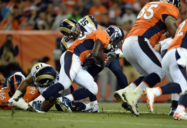 Aug 24, 2013; Denver, CO, USA; St. Louis Rams defensive end William Hayes (95) is unable to stop the rushing touchdown by Denver Broncos running back Montee Ball (38) in the third quarter at Sports Authority Field .The Broncos defeated the Rams 27-26. Mandatory Credit: Ron Chenoy-USA TODAY Sports
