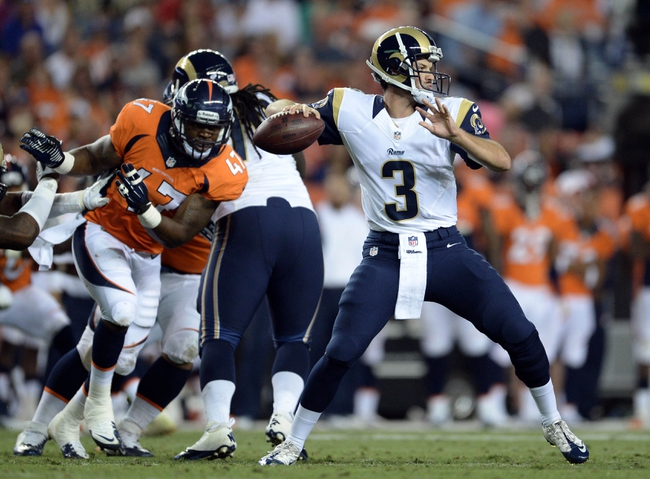 Aug 24, 2013; Denver, CO, USA; St. Louis Rams quarterback Tim Jenkins (3) prepares to pass during the game against the Denver Broncos at Sports Authority Field .The Broncos defeated the Rams 27-26. Mandatory Credit: Ron Chenoy-USA TODAY Sports