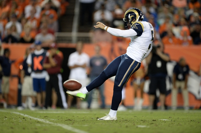 Aug 24, 2013; Denver, CO, USA; St. Louis Rams kicker Brett Baer (5) punts away during the game against the Denver Broncos in the fourth quarter at Sports Authority Field .The Broncos defeated the Rams 27-26. Mandatory Credit: Ron Chenoy-USA TODAY Sports