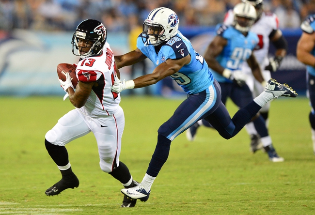 Aug 24, 2013; Nashville, TN, USA; Atlanta Falcons wide receiver Darius Johnson (13) catches a pass and runs for a touchdown against Tennessee Titans cornerback Blidi Wreh-Wilson (29) during the second half at LP Field. The Titans beat the Falcons 27-16. Mandatory Credit: Don McPeak-USA TODAY Sports