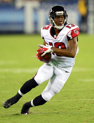 Aug 24, 2013; Nashville, TN, USA; Atlanta Falcons wide receiver Darius Johnson (13) runs for a touchdown against the Tennessee Titans during the second half at LP Field. The Titans beat the Falcons 27-16. Mandatory Credit: Don McPeak-USA TODAY Sports