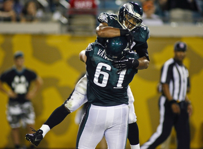 Aug 24, 2013; Jacksonville, FL, USA; Philadelphia Eagles running back Chris Polk (32) celebrates with guard Julian Vandervelde (61) after scoring the game-winning touchdown during the fourth quarter of their game against the Jacksonville Jaguars at EverBank Field. The Philadelphia Eagles beat the Jacksonville Jaguars 31-24. Mandatory Credit: Phil Sears-USA TODAY Sports