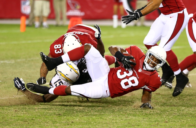Aug. 24, 2013; Glendale, AZ, USA: Arizona Cardinals running back Andre Ellington (38) in the third quarter against the San Diego Chargers during a preseason game at University of Phoenix Stadium. Mandatory Credit: Mark J. Rebilas-USA TODAY Sports