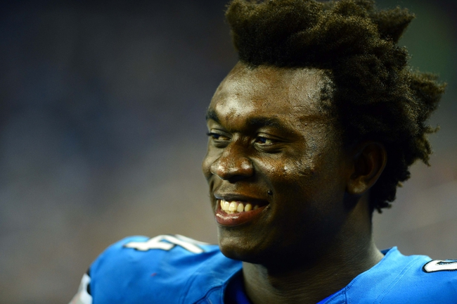 Aug 22, 2013; Detroit, MI, USA; Detroit Lions defensive end Ezekiel Ansah (94) during a preseason game against the New England Patriots at Ford Field. Mandatory Credit: Andrew Weber-USA TODAY Sports