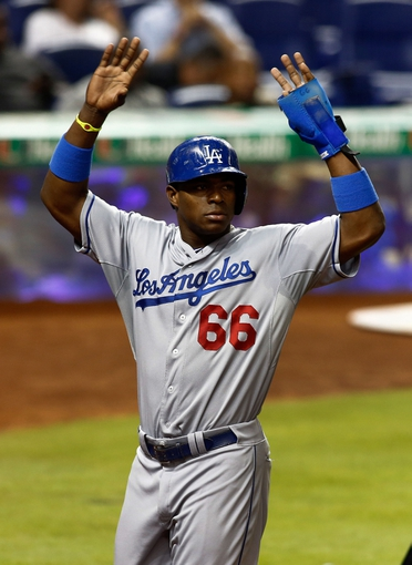 Aug 21, 2013; Miami, FL, USA;  Los Angeles Dodgers right fielder Yasiel Puig (66) reacts after scoring in the fourth inning against the Miami Marlins at Marlins Park. Mandatory Credit: Robert Mayer-USA TODAY Sports