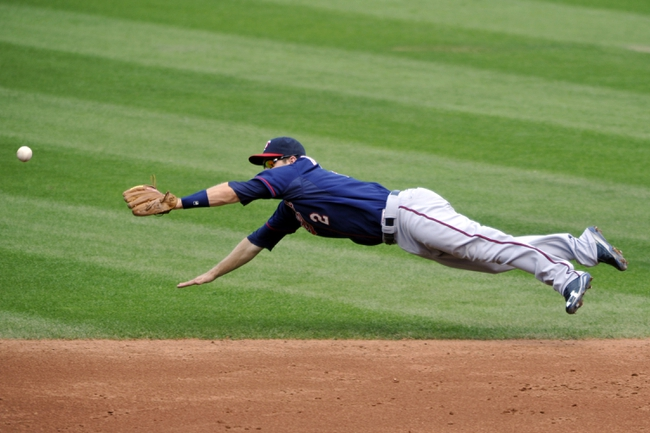 Aug 25, 2013; Cleveland, OH, USA; Minnesota Twins second baseman Brian Dozier (2) dives for a base hit by Cleveland Indians shortstop Asdrubal Cabrera (not pictured) in the second inning at Progressive Field. Mandatory Credit: David Richard-USA TODAY Sports