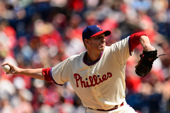 Aug 25, 2013; Philadelphia, PA, USA; Philadelphia Phillies pitcher Roy Halladay (34) delivers to the plate during the first inning against the Arizona Diamondbacks at Citizens Bank Park. Mandatory Credit: Howard Smith-USA TODAY Sports