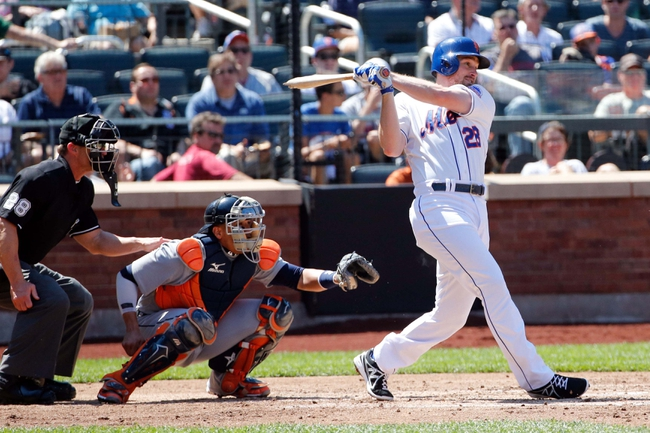 Aug 25, 2013; New York, NY, USA;  New York Mets second baseman Daniel Murphy (28) singles to shallow center allowing a runner to score during the third inning against the Detroit Tigers at Citi Field. Mandatory Credit: Anthony Gruppuso-USA TODAY Sports