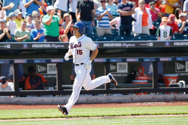 Aug 25, 2013; New York, NY, USA; New York Mets catcher Travis d'Arnaud (15) rounds the bases after hitting a two-run home run during the fourth inning against the Detroit Tigers at Citi Field. Mandatory Credit: Anthony Gruppuso-USA TODAY Sports