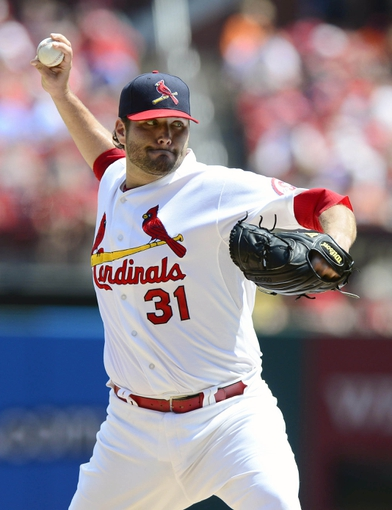 Aug 25, 2013; St. Louis, MO, USA; St. Louis Cardinals starting pitcher Lance Lynn (31) throws to a Atlanta Braves batter during the second inning at Busch Stadium. Mandatory Credit: Jeff Curry-USA TODAY Sports