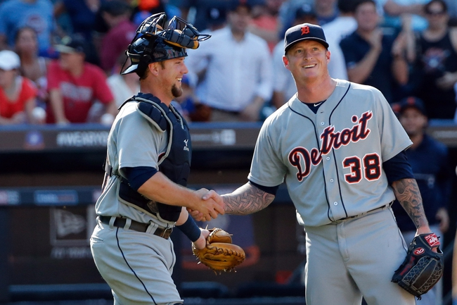 Aug 25, 2013; New York, NY, USA; Detroit Tigers starting pitcher Jeremy Bonderman (38) and catcher Bryan Holaday (50) celebrate the win against the New York Mets  at Citi Field. Detroit won 11-3.  Mandatory Credit: Anthony Gruppuso-USA TODAY Sports