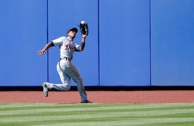 Aug 25, 2013; New York, NY, USA;  Detroit Tigers center fielder Austin Jackson (14) makes a catch on a ball hit by New York Mets catcher Travis d'Arnaud (15) (not pictured) for an out during the seventh inning at Citi Field. Mandatory Credit: Anthony Gruppuso-USA TODAY Sports