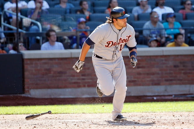Aug 25, 2013; New York, NY, USA;  Detroit Tigers left fielder Matt Tuiasosopo (18) singles to center allowing a runner to score during the ninth inning against the New York Mets at Citi Field. Detroit won 11-3.  Mandatory Credit: Anthony Gruppuso-USA TODAY Sports