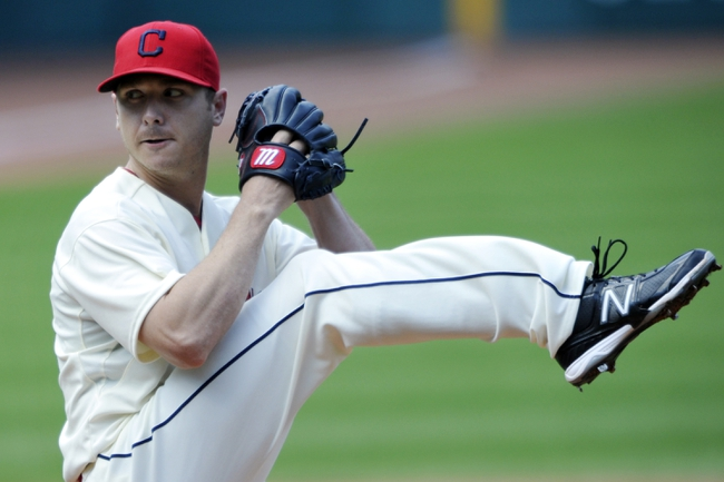 Aug 25, 2013; Cleveland, OH, USA; Cleveland Indians starting pitcher Scott Kazmir (26) delivers in the fourth inning against the Minnesota Twins at Progressive Field. Mandatory Credit: David Richard-USA TODAY Sports