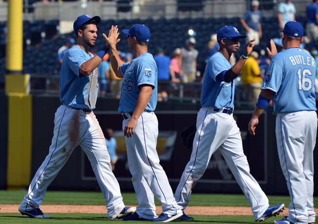 Aug 25, 2013; Kansas City, MO, USA; Kansas City Royals players Eric Hosmer (35) , George Kattaras (26) , Alcides Escobar (2) and Billy Butler celebrate after beating the Washington Nati