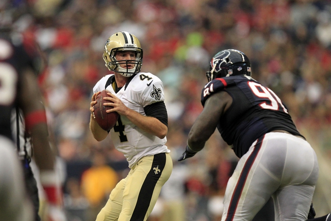 Aug 25, 2013; Houston, TX, USA; New Orleans Saints quarterback Ryan Griffin (4) drops back to pass as he is rushed by Houston Texans defensive tackle Daniel Muir (91) during the second half at Reliant Stadium. The Saints won 31-23. Mandatory Credit: Thomas Campbell-USA TODAY Sports