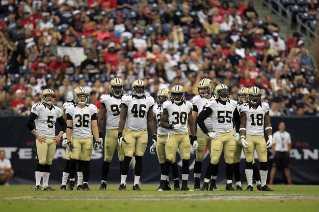 Aug 25, 2013; Houston, TX, USA; The New Orleans Saints wait during a timeout against the Houston Texans during the second half at Reliant Stadium. The Saints won 31-23. Mandatory Credit: Thomas Campbell-USA TODAY Sports