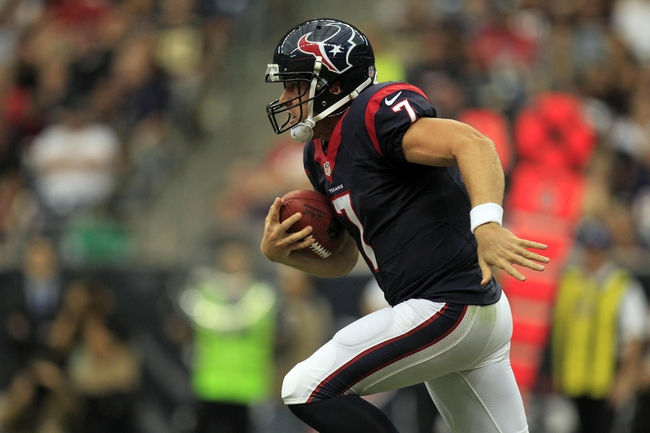 Aug 25, 2013; Houston, TX, USA; Houston Texans quarterback Case Keenum (7) rushes against the New Orleans Saints during the second half at Reliant Stadium. The Saints won 31-23. Mandatory Credit: Thomas Campbell-USA TODAY Sports