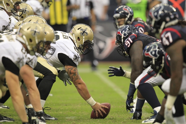 Aug 25, 2013; Houston, TX, USA; New Orleans Saints center Eric Olsen (69) snaps the ball against the Houston Texans during the second half at Reliant Stadium. The Saints won 31-23. Mandatory Credit: Thomas Campbell-USA TODAY Sports