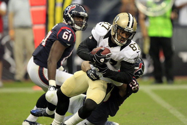 Aug 25, 2013; Houston, TX, USA; Houston Texans defensive back Brandon Harris (26) tackles New Orleans Saints wide receiver Preston Parker (87) during the second half at Reliant Stadium. The Saints won 31-23. Mandatory Credit: Thomas Campbell-USA TODAY Sports