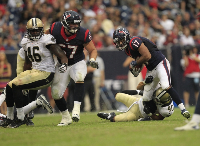 Aug 25, 2013; Houston, TX, USA; New Orleans Saints defensive back Chris Carr (40) tackles Houston Texans wide receiver Alec Lemon (17) during the second half at Reliant Stadium. The Saints won 31-23. Mandatory Credit: Thomas Campbell-USA TODAY Sports