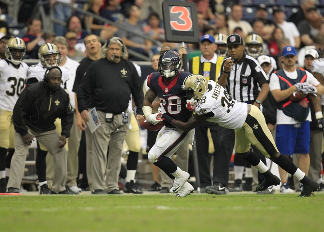 Aug 25, 2013; Houston, TX, USA; New Orleans Saints cornerback Rod Sweeting (38) forces a fumble from Houston Texans running back Dennis Johnson (28) during the second half at Reliant Stadium. The Saints won 31-23. Mandatory Credit: Thomas Campbell-USA TODAY Sports
