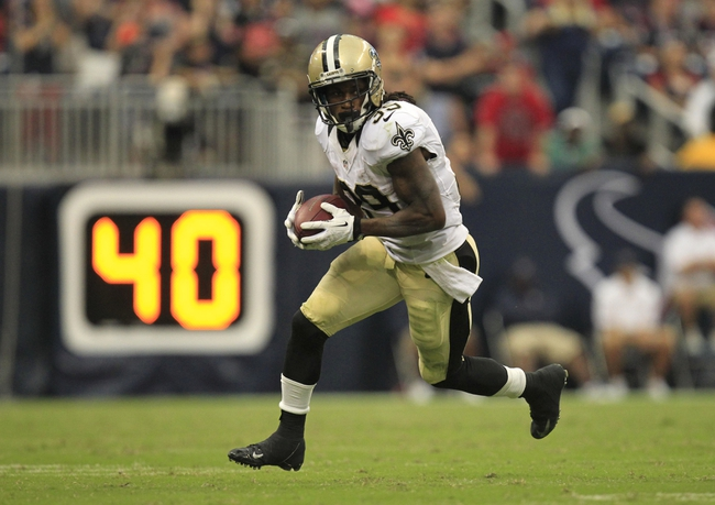 Aug 25, 2013; Houston, TX, USA; New Orleans Saints running back Travaris Cadet (39) runs after a catch against the Houston Texans during the second half at Reliant Stadium. The Saints won 31-23. Mandatory Credit: Thomas Campbell-USA TODAY Sports