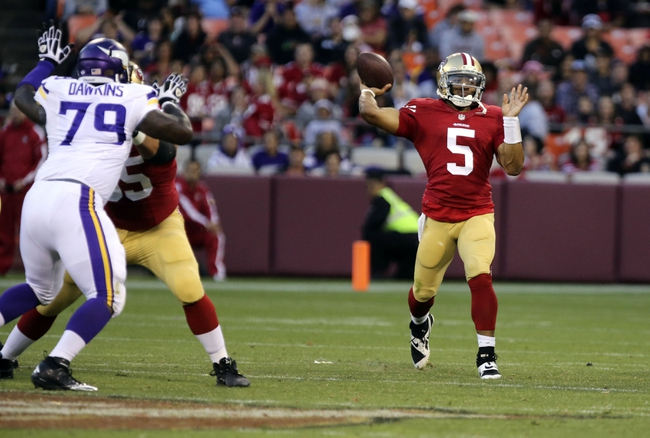 Aug 25, 2013; San Francisco, CA, USA; San Francisco 49ers quarterback B.J. Daniels (5) passes the ball against the Minnesota Vikings during the fourth quarter at Candlestick Park. The San Francisco 49ers defeated the Minnesota Vikings 34-14. Mandatory Credit: Kelley L Cox-USA TODAY Sports
