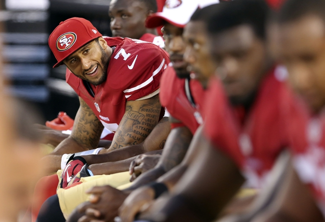 Aug 25, 2013; San Francisco, CA, USA; San Francisco 49ers quarterback Colin Kaepernick (7) smiles on the bench during the fourth quarter against the Minnesota Vikings at Candlestick Park. The San Francisco 49ers defeated the Minnesota Vikings 34-14. Mandatory Credit: Kelley L Cox-USA TODAY Sports