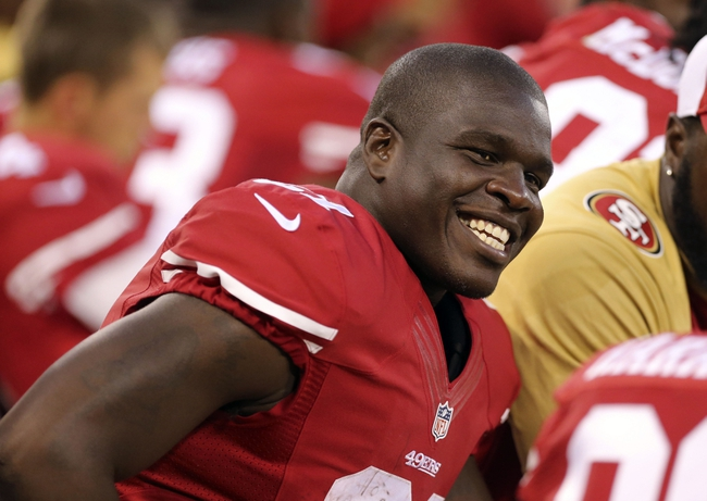 Aug 25, 2013; San Francisco, CA, USA; San Francisco 49ers running back Frank Gore (21) smiles on the bench during the fourth quarter against the Minnesota Vikings at Candlestick Park. The San Francisco 49ers defeated the Minnesota Vikings 34-14. Mandatory Credit: Kelley L Cox-USA TODAY Sports